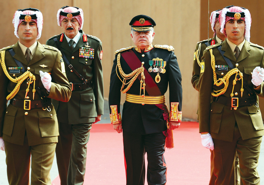 JORDAN'S KING Abdullah reviews the honour guard before the opening of the second ordinary session of