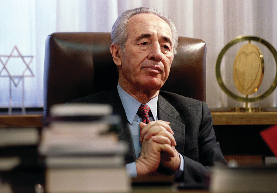 THE LATE Shimon Peres at his desk in 1994.