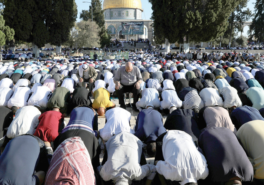 PALESTINIAN MEN pray on the Temple Mount as they mark the Muslim holiday of Eid al-Adha on August 11. (Credit: AMMAR AWAD / REUTERS)