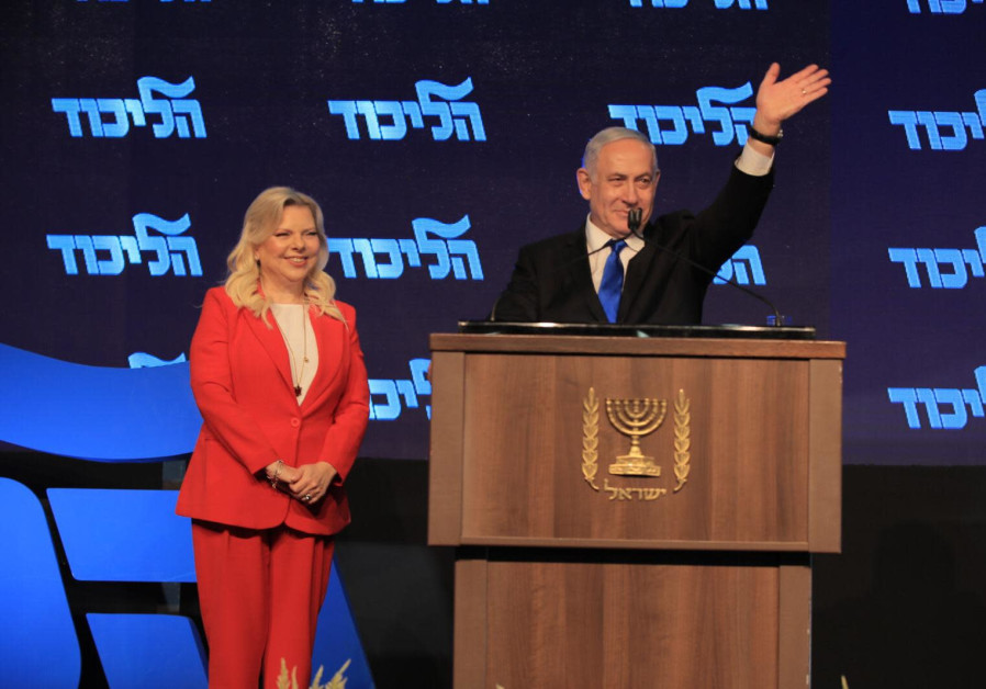 Prime Minister Benjamin Netanyahu stands on stage with wife Sara at Likud's New Years Toast, Septemb