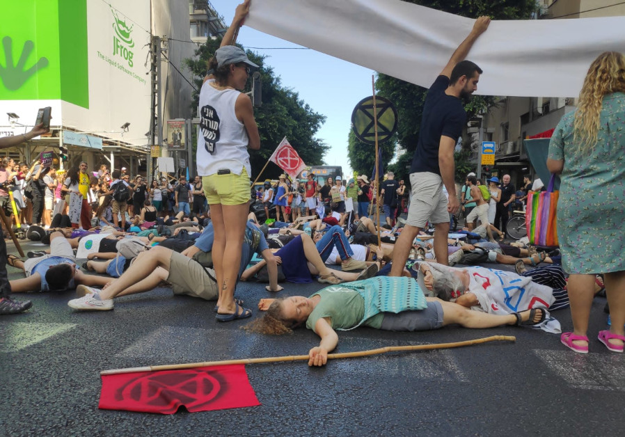 Thousands protest climate change in the streets of Tel Aviv.