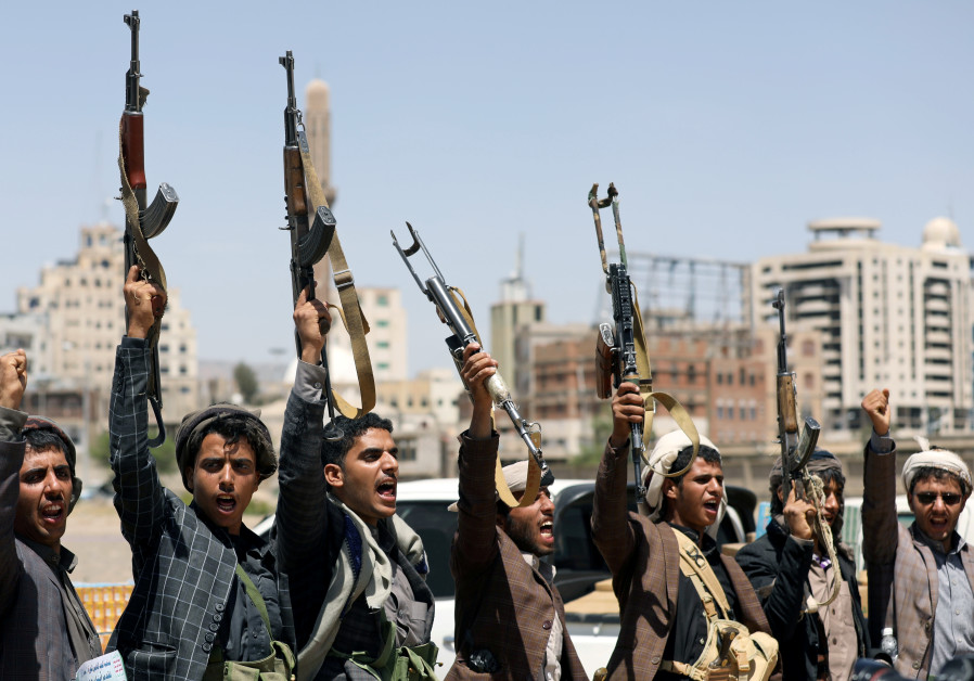 Houthi followers attend a gathering to receive food supplies from tribesmen in Sanaa, Yemen Septembe