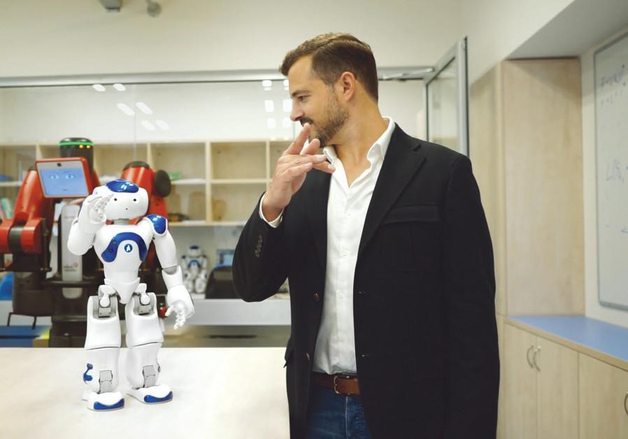 AI ROBOT Nao teaches 'TechTalk' host and executive producer Jonny Caplan how to do Tai Chi in the Cu
