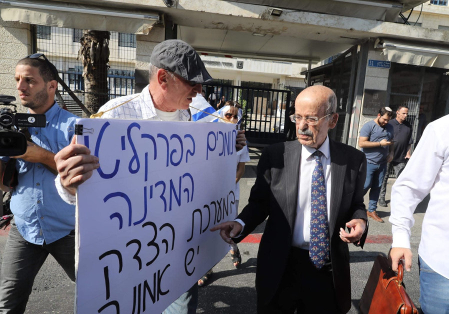 Prime Minister Benjamin Netanyahu's defense attorney Ram Caspi arrives at court for the PM's pre-ind