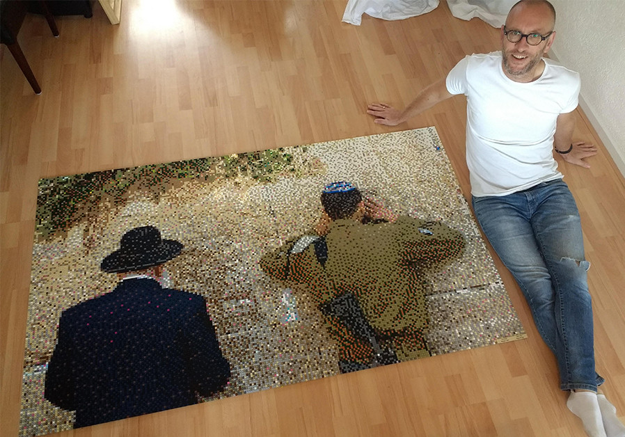 HARRO BOS and his finished mosaic in LEGO bricks. (Credit: Courtesy)