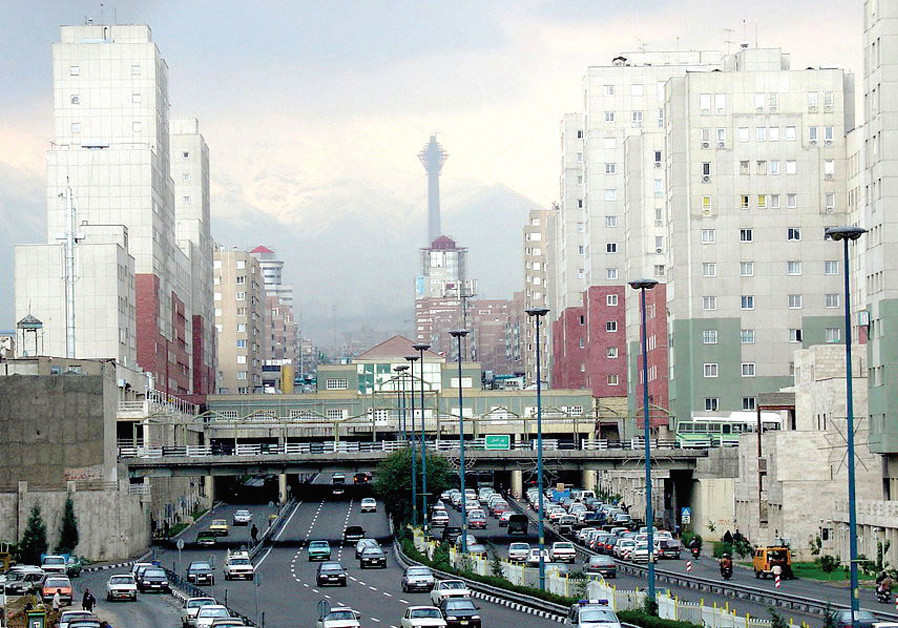 Navvab Street, with Milad Tower and snow on the Alborz Mountains in the distance, 2005. (Credit: Wikimedia Commons)