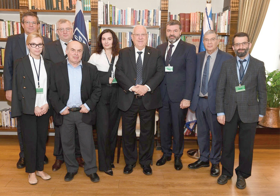 PRESIDENT REUVEN RIVLIN (center) meets with Babi Yar Holocaust Memorial Center Advisory Board chairman Natan Sharansky (second from left); Dr. Arkadi Zeltser (far right), director of the Moshe Mirilashvili Center for Research of the Holocaust in the Soviet Union: International Institute for Holocaus (Credit: PR)