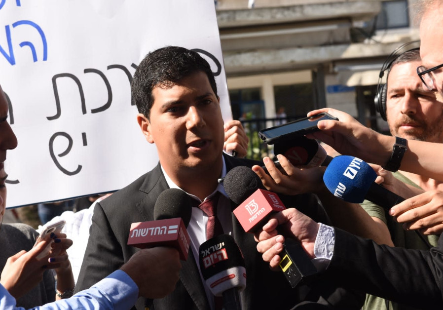 Benjamin Netanyahu's lawyer Amit Hadad speaks to the press at day one of the PM's pre-indictment hea