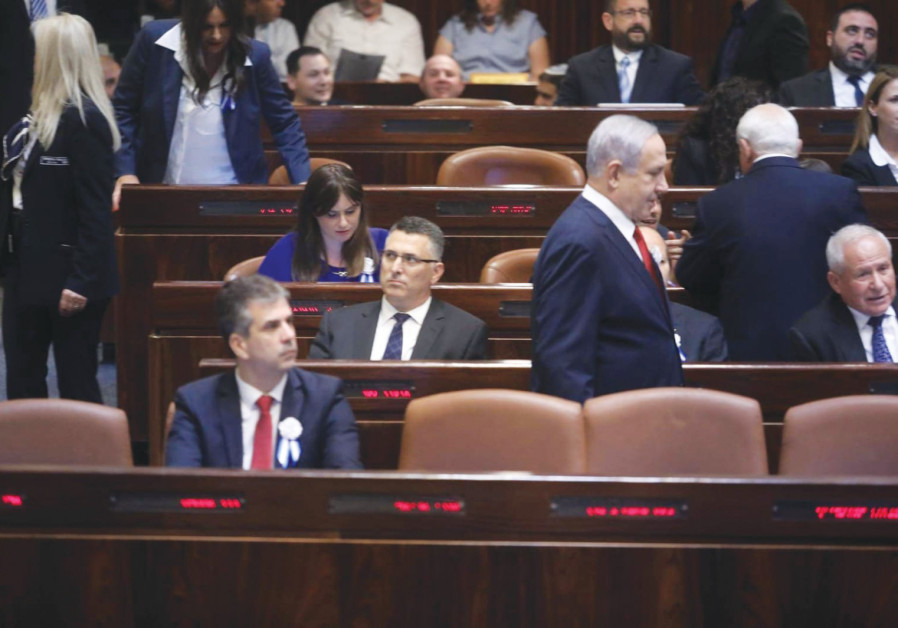 PRIME MINISTER Benjamin Netanyahu walks past Gideon Sa'ar in the Knesset yesterday