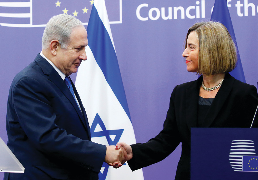 ISRAEL'S PRIME Minister Benjamin Netanyahu shakes hands with European Union foreign policy chief Fed