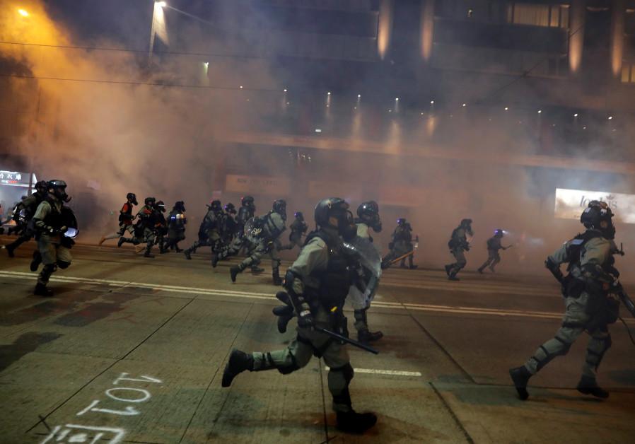 Hundreds crowd Hong Kong streets as metro shuts after violence