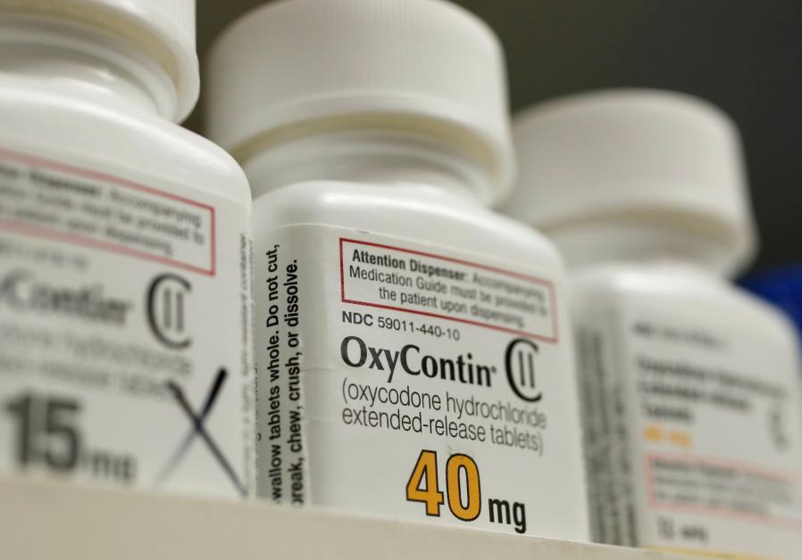 Bottles of prescription painkiller OxyContin, 40mg pills, made by Purdue Pharma L.D. sit on a shelf