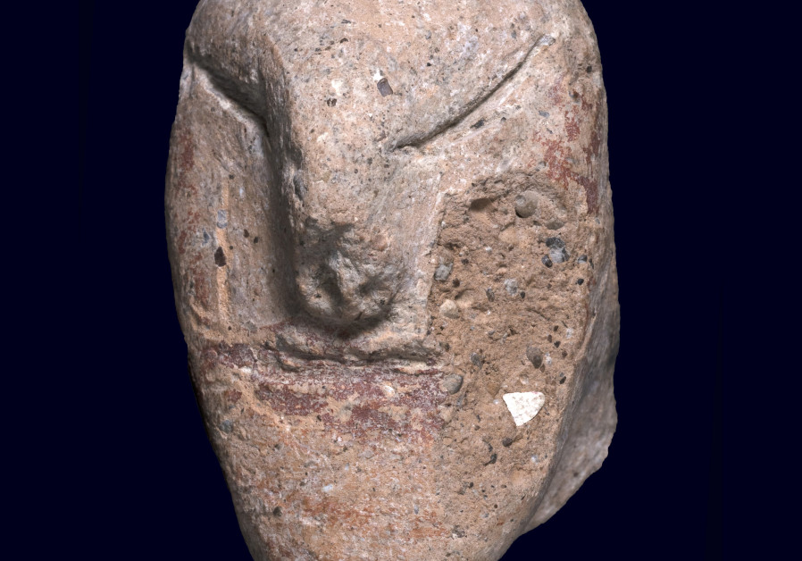 The icon of a 5,000 year ago human head (Photo Credit: Clara Amit/ Israel Antiquities Authority)