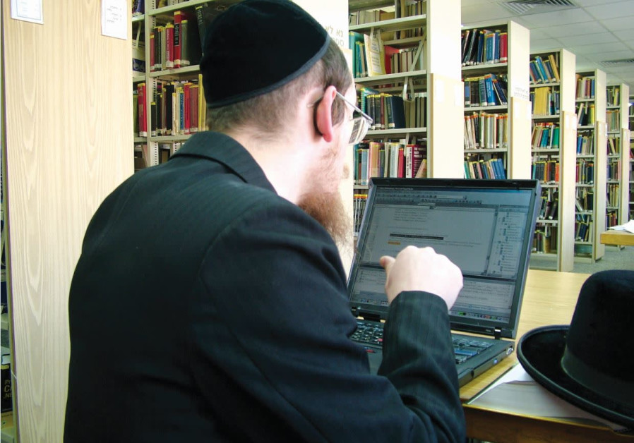 A HAREDI STUDENT works on a computer  at the Jerusalem College of Technology.