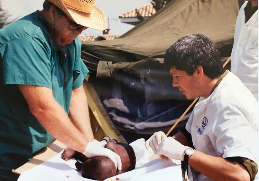 PROF. NATI KELLER working at a field hospital in Rwanda in the early 1990s.