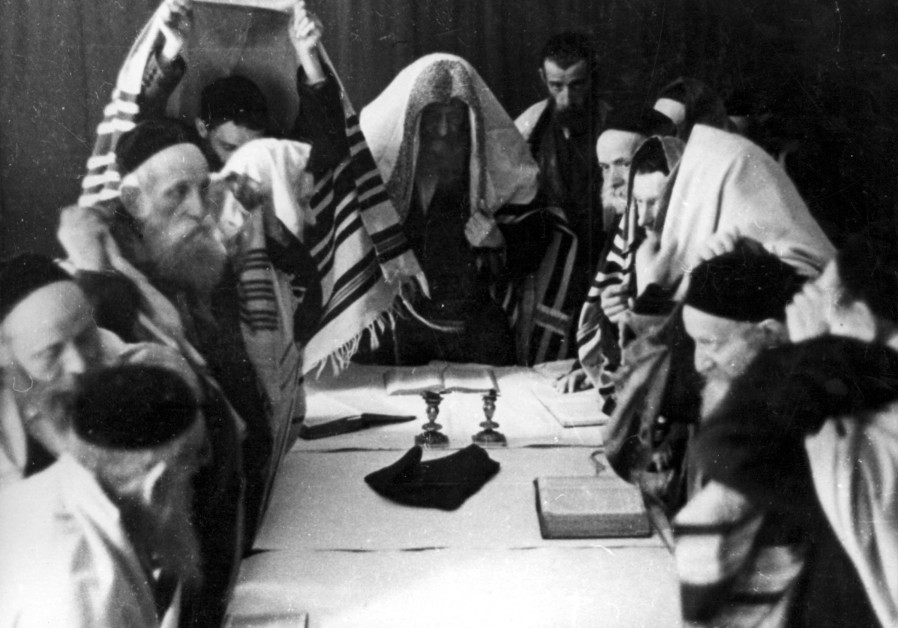 Religious men praying in Krakow Ghetto on Yom Kippur 1940.