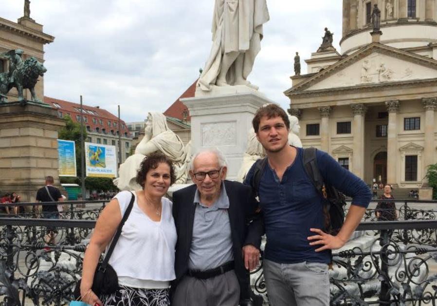 Alina Tugend,  Tom Tugend and Dr. Benjamin Kuntz pose at Berlin's central Gendarmenmarkt