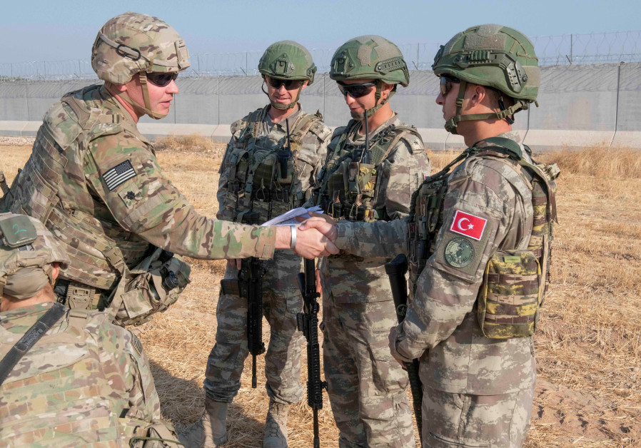 U.S. and Turkish military forces conduct a joint ground patrol inside the security mechanism area in