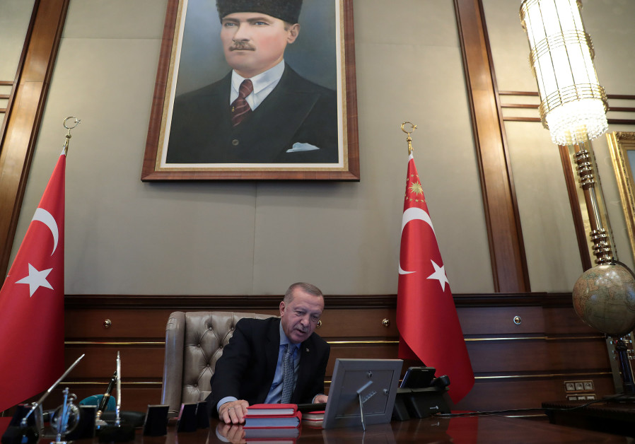 Turkish President Tayyip Erdogan speaks to Defence Minister Hulusi Akar on the phone at the Presiden
