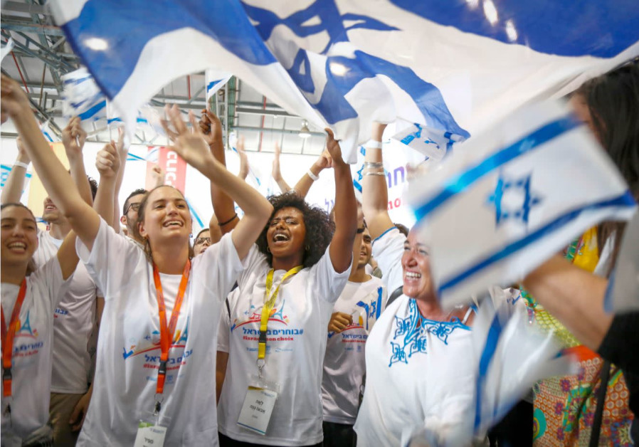 AN ENTHUSIASTIC welcome for new immigrants from France with T-shirts bearing the hashtag (in Hebrew)