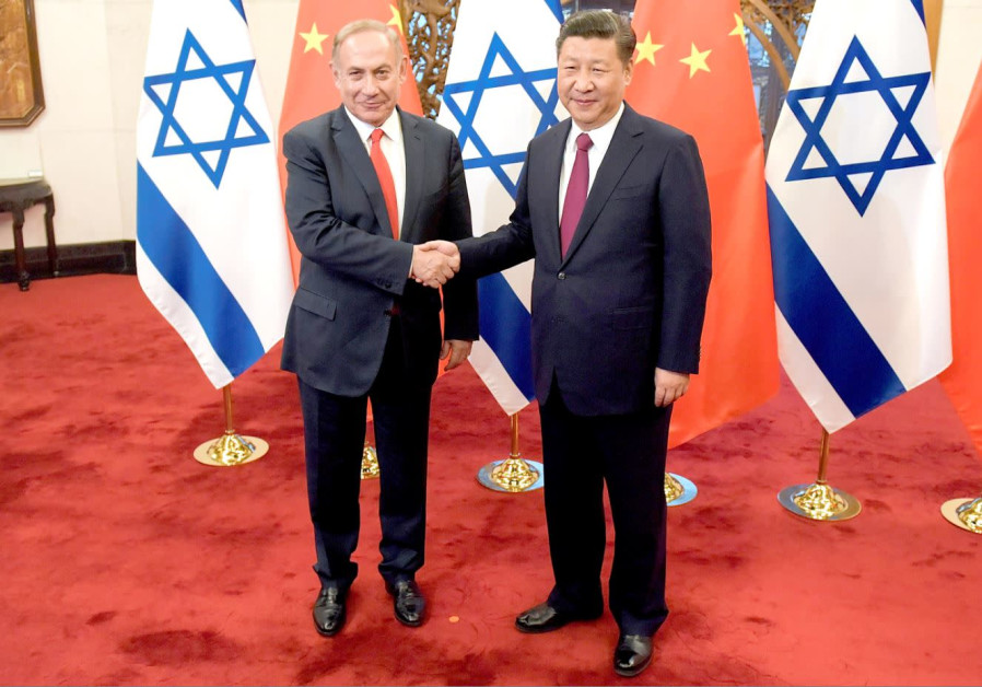 PRIME MINISTER Benjamin Netanyahu and Chinese President Xi Jinping shake hands ahead of their talks