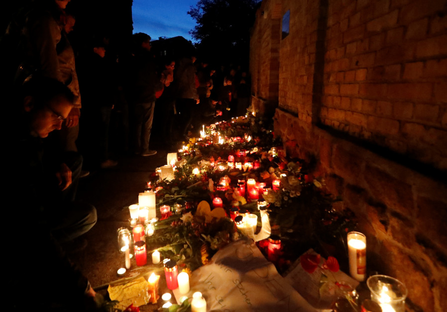 Mourners gather at the synagogue in Halle, Germany.