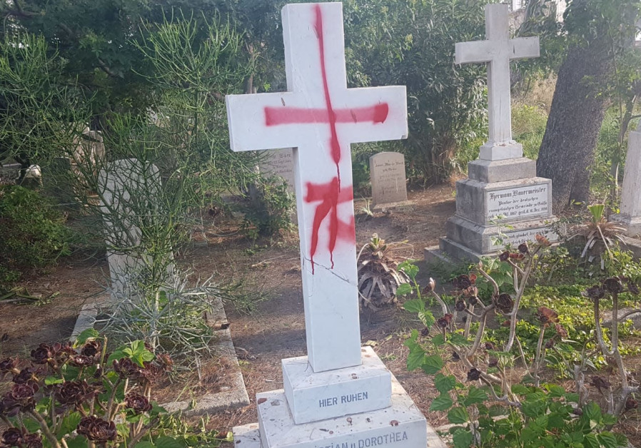 Tombstones desecrated with graffiti at the British cemetery in Haifa
