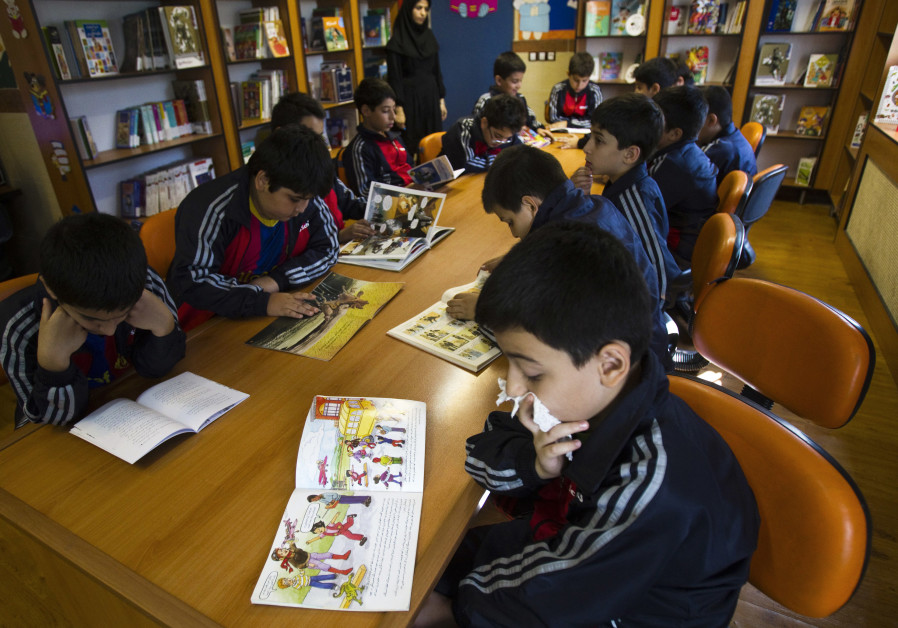 Students read in the library at Pishtaz School in Tehran