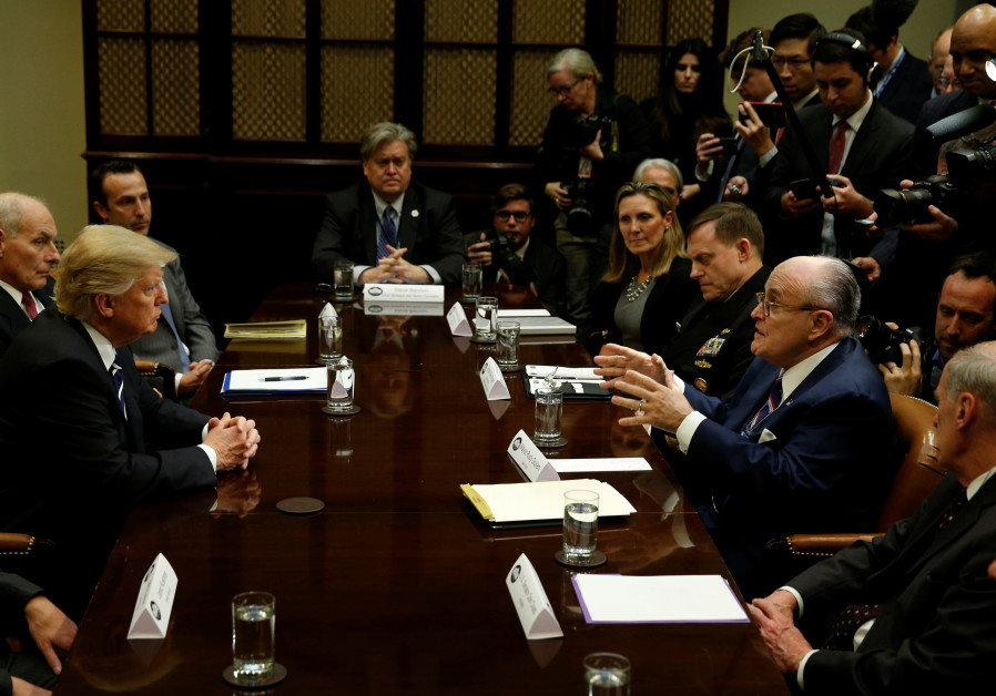 U.S. President Donald Trump listens to former New York City Mayor Rudy Giuliani during a meeting wit
