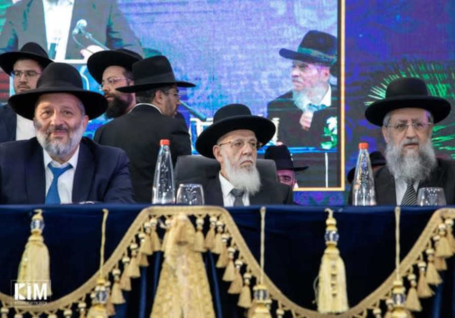 Spiritual leader of the Shas party Rabbi Shalom Cohen (center), flanked by Shas party chairman and I