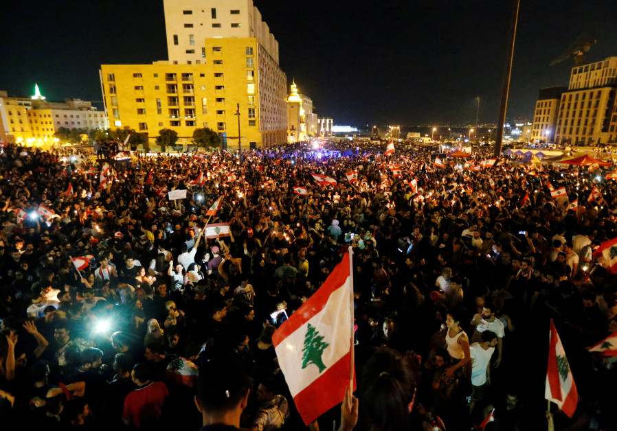 Lebanon shaken by third day of protests with some denouncing Hezbollah