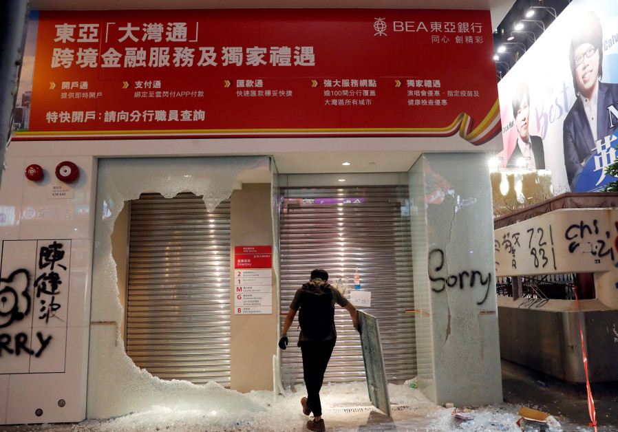 Hong Kong firms pick up pieces from protest damage