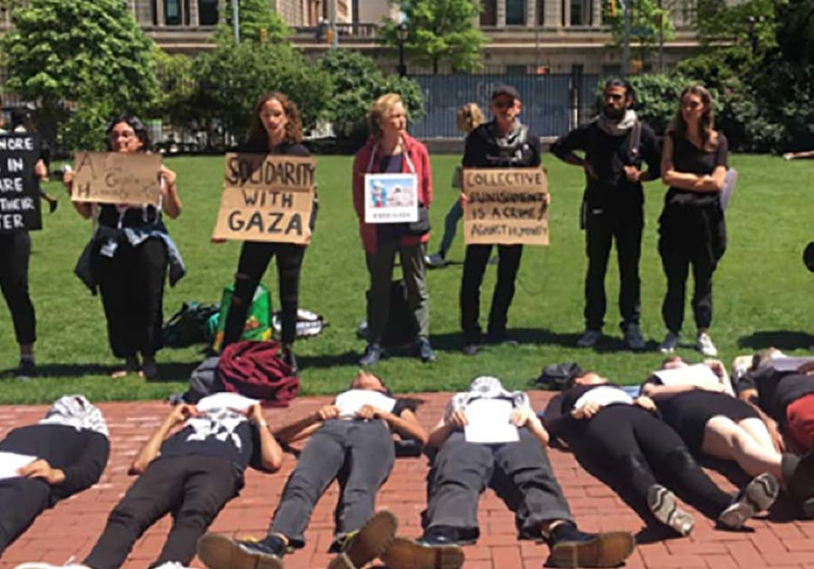 "Students at Columbia University hold a ""die-in"" demonstration"