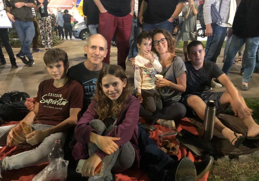Geva and Yaakobi with their family at the Yitzhak Rabin rally, November 2, 2019 (Photo Credit: Anna Ahronheim/Rachel Wolf)