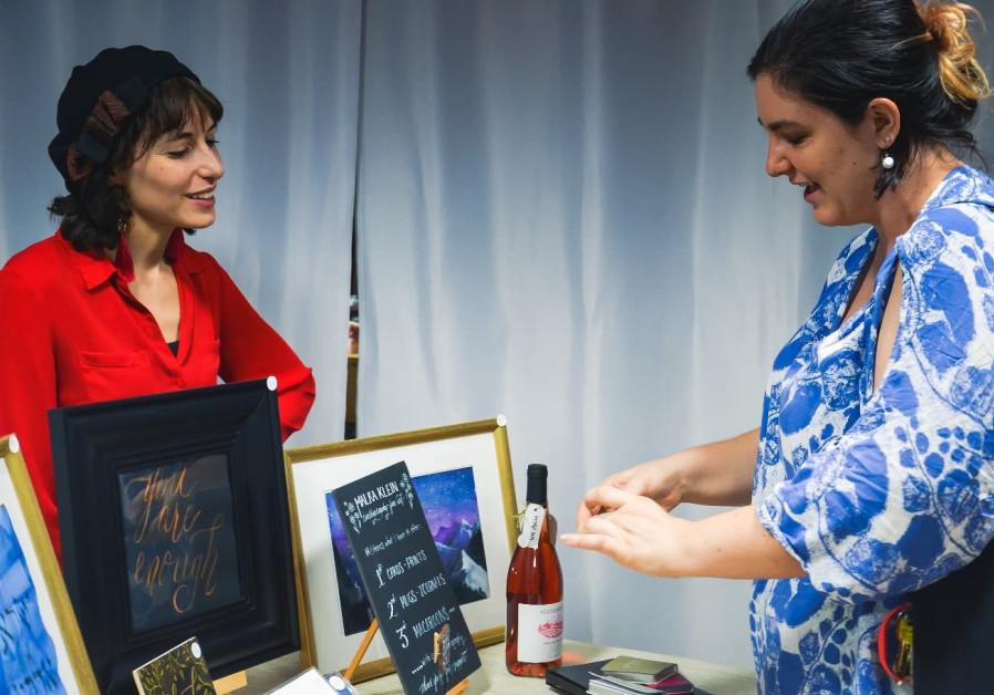 Malka Klein, a calligrapher and fine artist, participates in a female entrepreneurship pop-up event, Jerusalem. (photo credit: REBECCA ZWIREN)