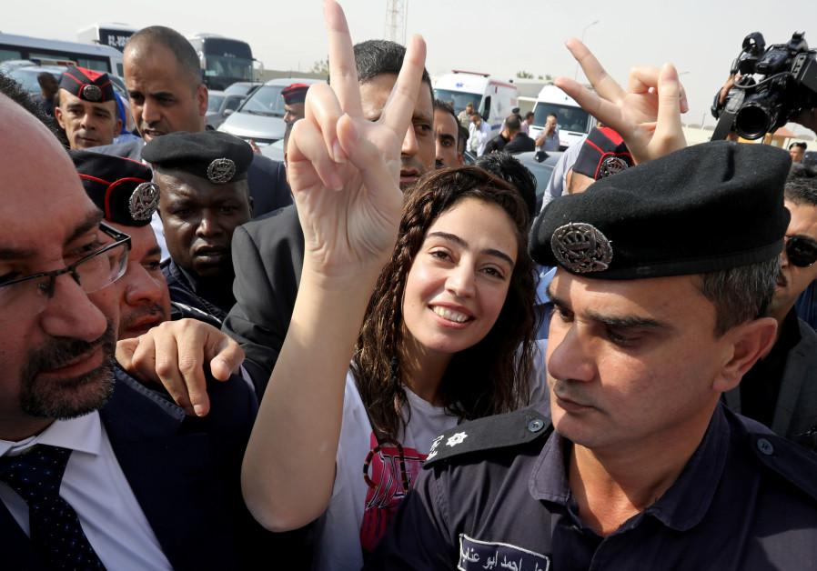 Jordanian citizen Hiba Labadi gestures upon her release by Israel, at the King Hussein Bridge crossi