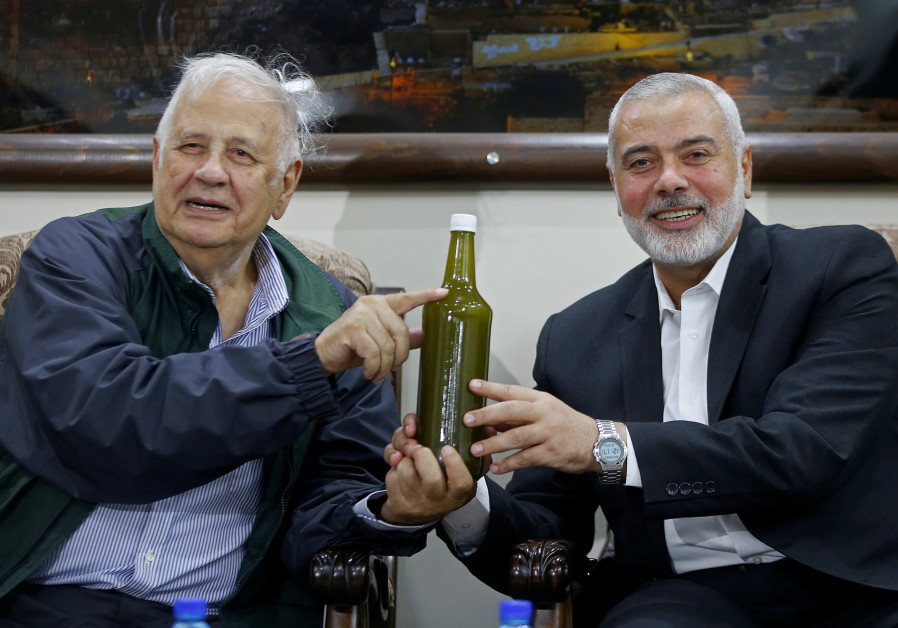 Palestinian Hamas Chief Ismail Haniyeh and Chairman of the Palestinian Central Election Committee Ha