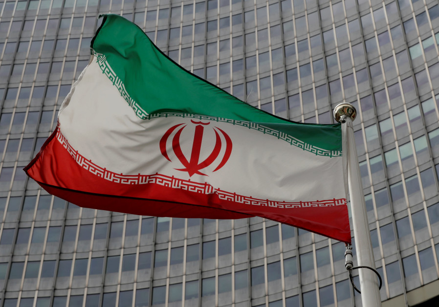 An Iranian flag flutters in front of the International Atomic Energy Agency (IAEA) headquarters in V