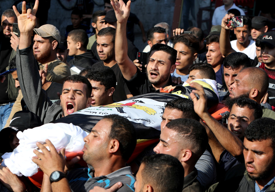 Mourners carry the body of Islamic Jihad commander Baha Abu Al-Atta during his Gaza funeral