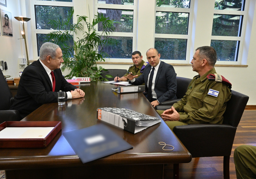 Prime Minister Benjamin Netanyahu and Defense Minister Naftali Bennett discuss the Gaza rocket attacks with IDF Chief of Staff Lt.-Gen. Aviv Kochavi on Tuesday. (MOD)