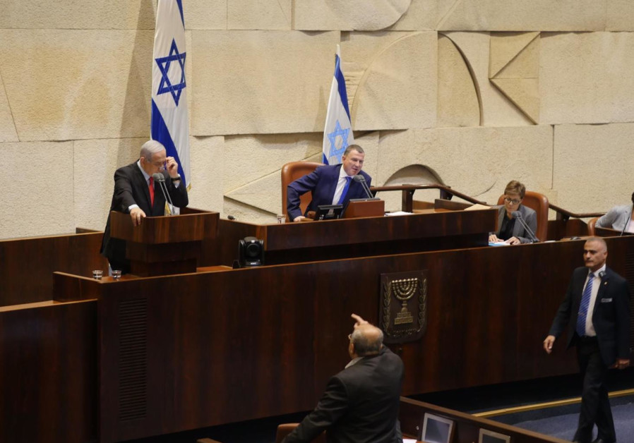 Joint List MK Ahmad Tibi yells at Prime Minister Netanyahu in the Knesset. (Knesset)