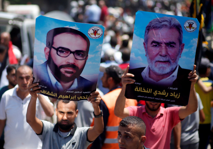 Palestinians hold posters of Islamic Jihad chief Ziyad al-Nakhalah (right) and late Islamic Jihad founder Fathi Shikaki during a protest in Gaza City earlier this year. (Mohammed Salem/Reuters)