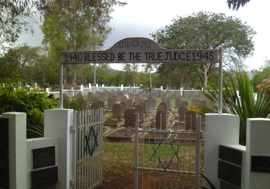 The gate to the Saint Martin Jewish Cemetery is seen opened. (Photo credit: EZRA TAYLOR)