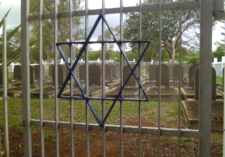 A star of David is seen on the gate of the Saint Martin Jewish Cemetery in Mauritius. (Photo credit: EZRA TAYLOR)