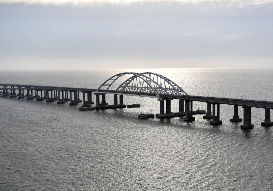 An aerial view shows a road-and-rail bridge, which was constructed to connect the Russian mainland with the Crimean peninsula, before the opening ceremony of its railway part, in the Kerch Strait December 23, 2019 (Photo Credit: SPUTNIK/ALEXEI NIKOLSKY/KREMLIN VIA REUTERS)