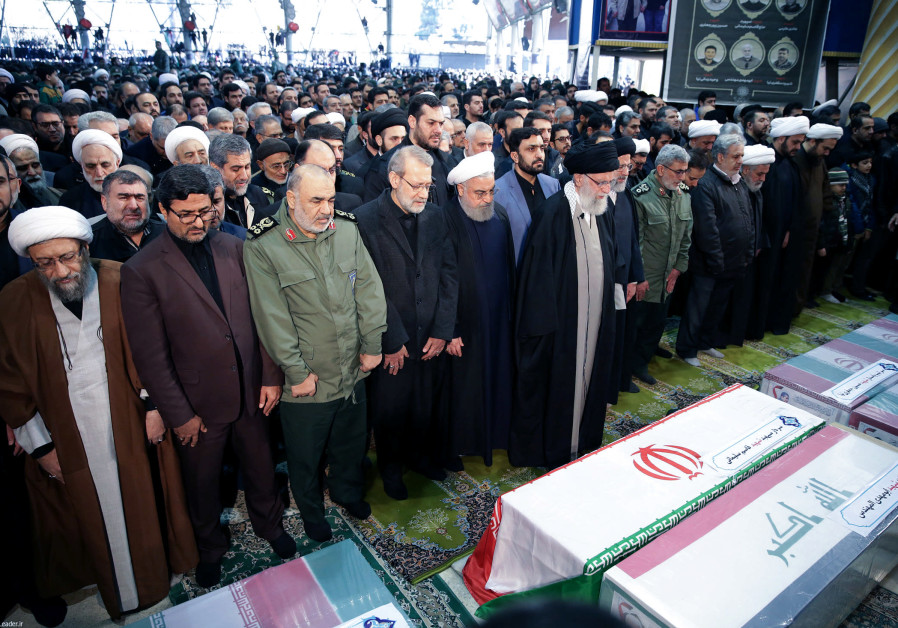 Iran's Supreme Leader Ayatollah Ali Khamenei and Iranian President Hassan Rouhani pray near the coffins of Iranian Major-General Qassem Soleimani, head of the elite Quds Force, and Iraqi militia commander Abu Mahdi al-Muhandis, who were killed in an air strike at Baghdad airport, in Tehran, Iran, January 6, 2020 (Photo Credit: Official President's Website/Handout via REUTERS)