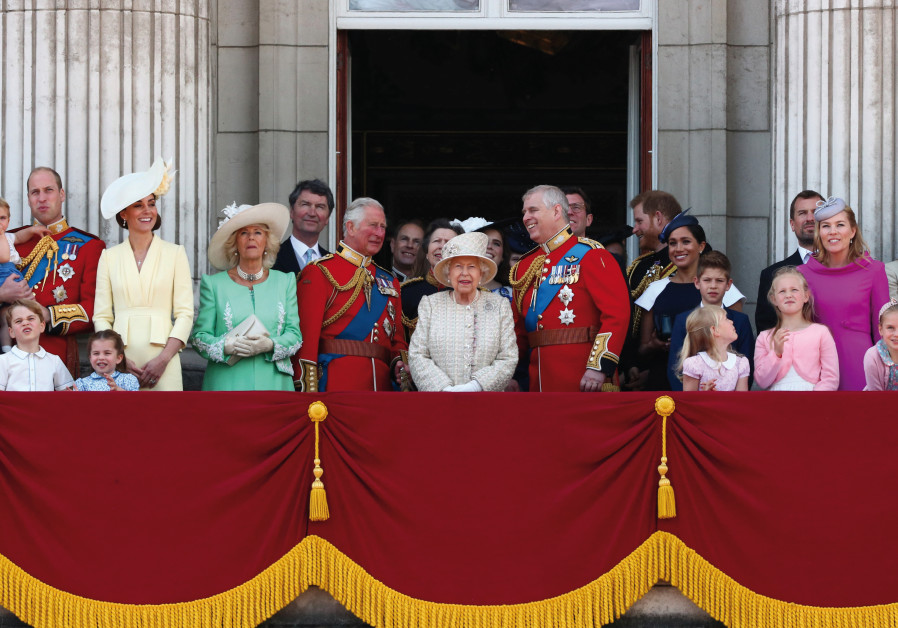 Queen Elizabeth, Prince Charles, Prince Harry, Prince William and Catherine, Duchess of Cambridge, along with other members of the British royal family, appear on the balcony as the Royal Air Force Aerobatic Team Red Arrows performs a flypast during Trooping the Colour parade in London on June 8, 20