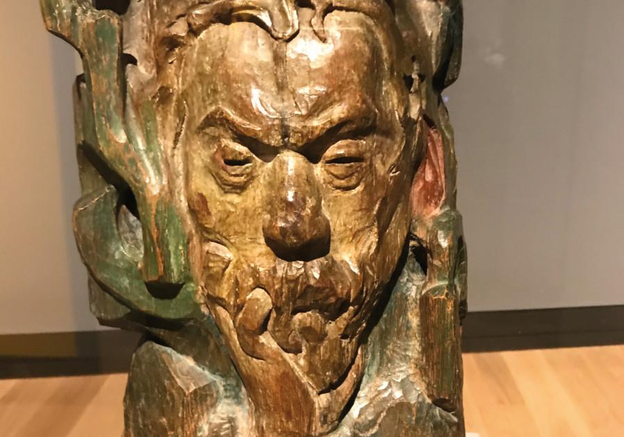 Gauguin's wooden sculpture of de Haan with cockerel