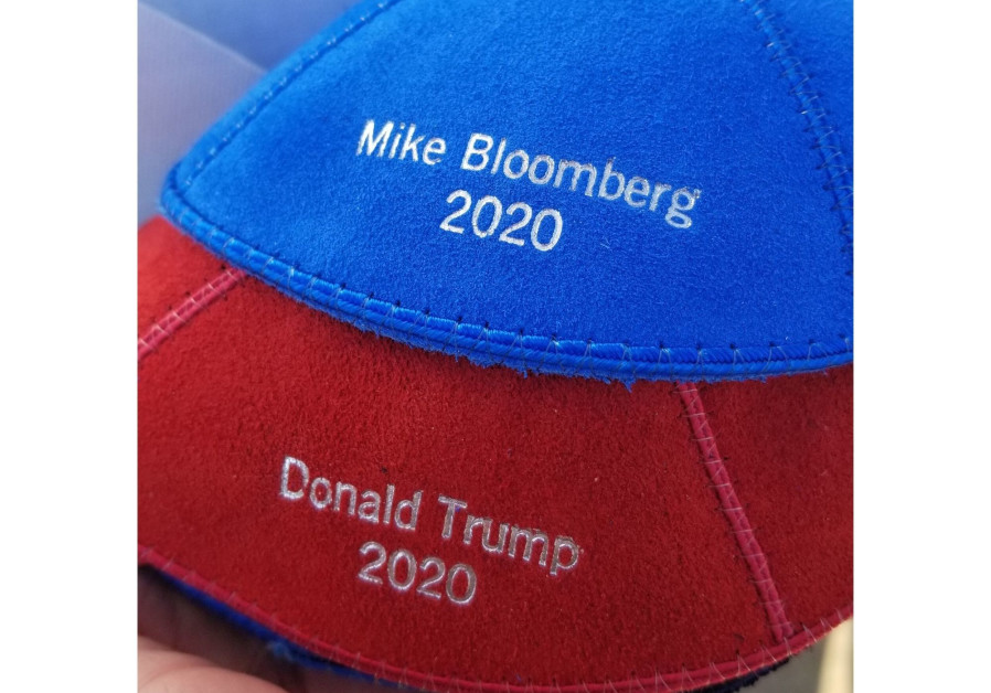 Marc Daniels sells political-themed kippot at the 2020 Iowa caucuses (Credit: Omri Namias)