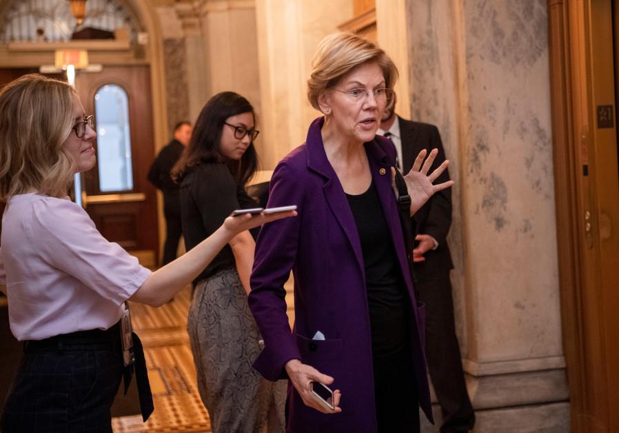 Senator Elizabeth Warren (D-MA) speaks with reporters following President Donald Trump's Senate impeachment trial in Washington on February 3, 2020